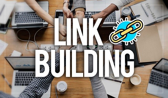 arms bumping fists across a table with LINK BUILDING overlaid in text