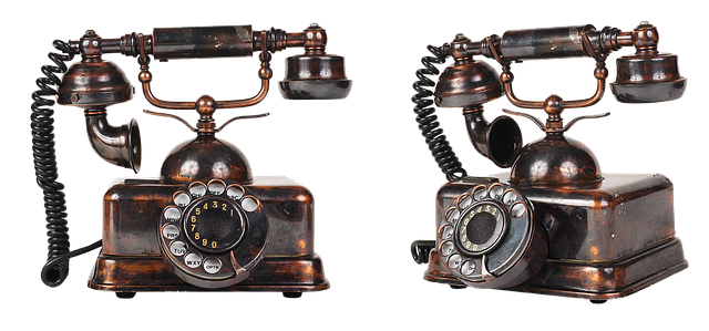 Two old fashioned telephones side by side. Image by Alexander Lesnitsky from Pixabay