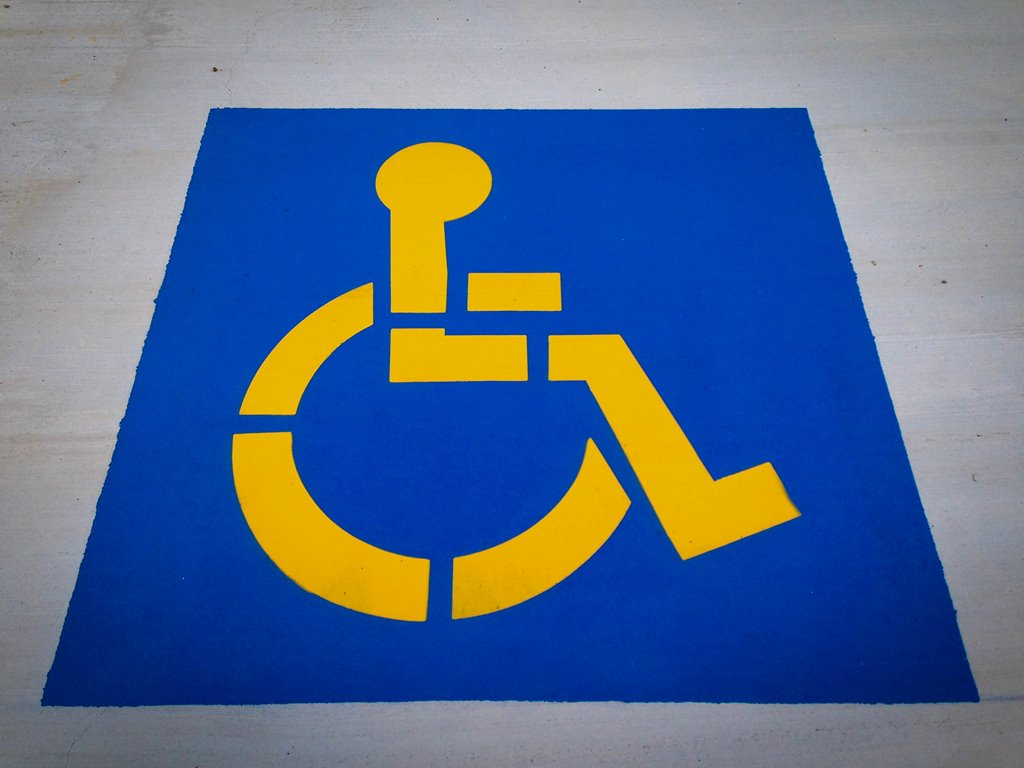 disabled floor sign in blue and yellow